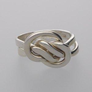 Zilveren ring knoop met 2 scharnierende beweegbare ringen
